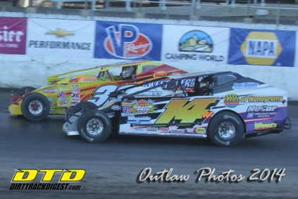"""The Jeffer Jeff Heotzler races Vic Coffey down the front stretch of the """"Moody Mile"""""""