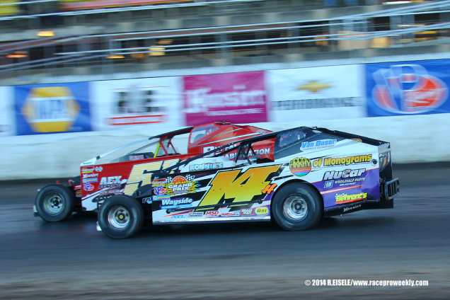 The Jeffer Jeff Heotzler races Dom Buffalino down the front stretch during the Syracuse 200