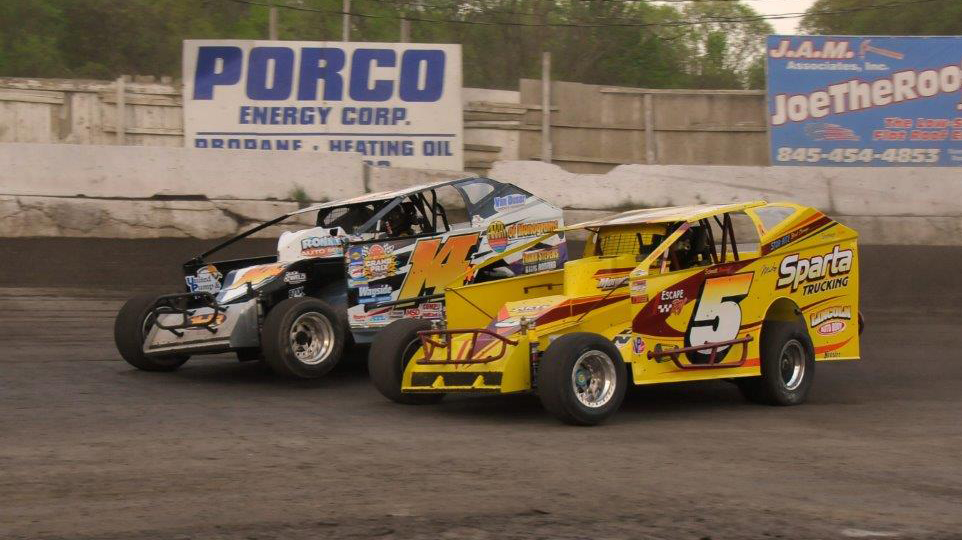 Jeff Heotzler, 14H, passes Tommy Meier on the outside of turns 3 and 4 at the Orange County Fair Speedway in Middletown, New York on May 9th, 2015.