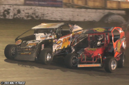Jeff Heotzler and Mike Ruggiero battle for position during the Eastern States 200 at the Orange County Fair Speedway!